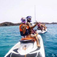 couple having fun on jet ski safari trip